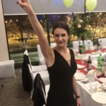 A lady in a black evening dress standing with victory gesture while posing in front of ball room on a business anniversary party in Hampton by Hilton hotel in Lublin, C2C-sp.-z-o.o.-c2c-www.ctoc.pl-business-class-vip-enterprise-polyethylene-foil-production; innovative-company-in-Lublin-in-Polish-region-of-lubelskie; #C2C; #eZaopatrzenie; #lublin