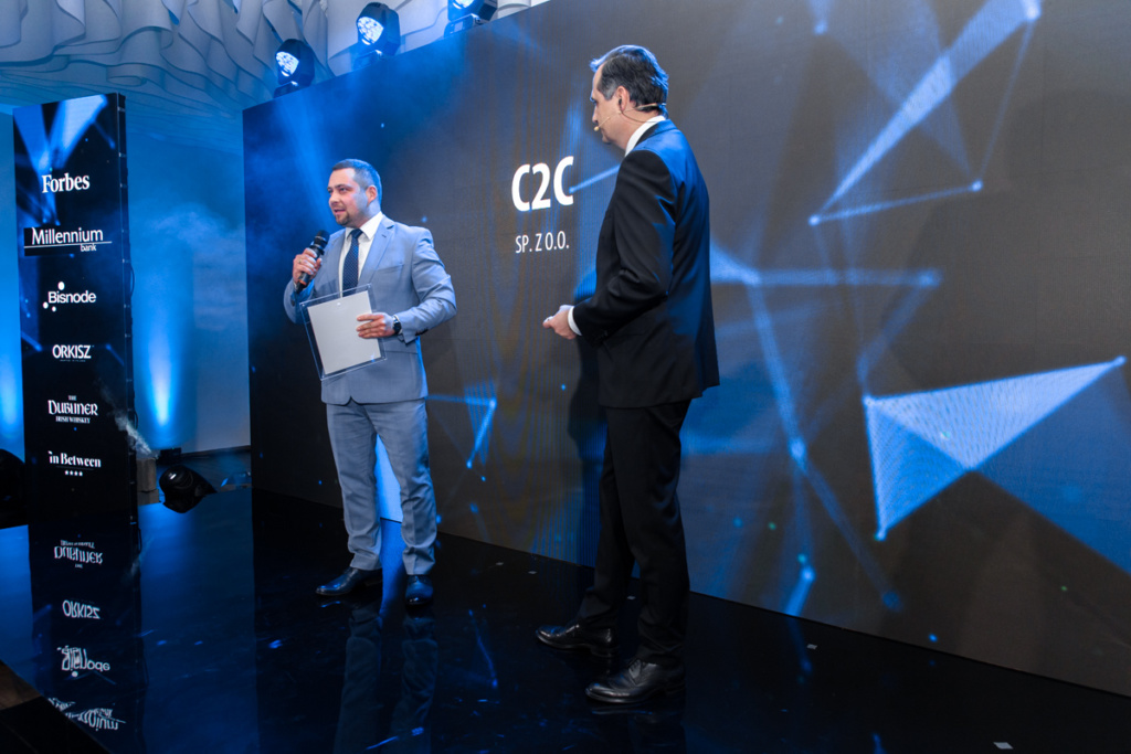 Businessman from C2C sp. z o. o. speaks to a host of Forbes Diamond event.