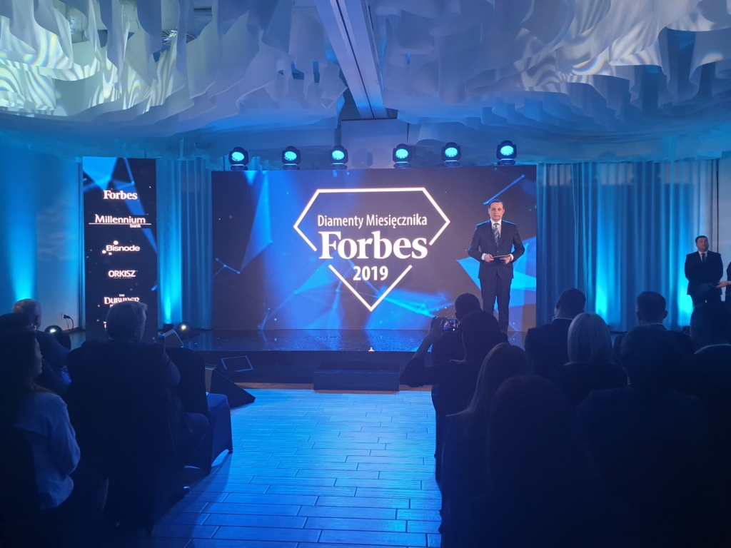 Host of event speaking to the audience during Forbes Diamonds 2019
